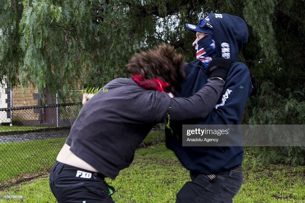 An Anti Fascist and True Blue Crew member clash during a 'Say No To Racism' protest and a counter 'Stop the Far Left' rally in Coburg Melbourne, Australia on May 28, 2016. Seven men were arrested after a violent brawl erupted between rival protesters at an anti-racism rally in Melbourne's inner-north. Anti-Facists clashed with Anti-Islam nationalists who go by the name 'True Blue Crew'.