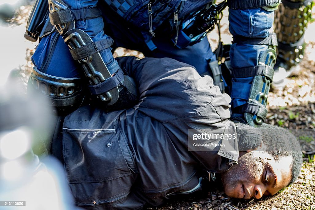 An anti fascist is held down to the ground by police as he is arrested during a protest organized by the anti-Islam True Blue Crew supported by the United Patriots Front in Melbourne, Australia on June 26, 2016.