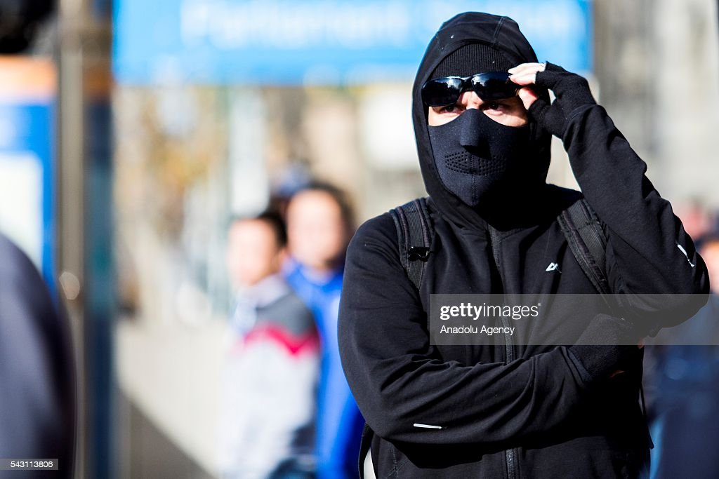 An anti fascist protester with a face mask looks towards the crowd during a protest organized by the anti-Islam True Blue Crew supported by the United Patriots Front in Melbourne, Australia on June 26, 2016.