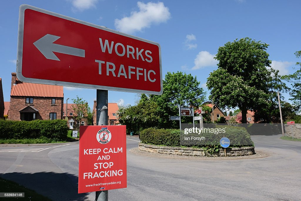 An anti fracking sign is tied to a works traffic sign in the village of Kirby Misperton on May 24 2016 in Malton England North Yorkshire Planning and...