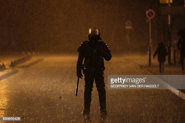 TOPSHOT An anti riot policeman stands guard as people gather in Bobigny northern Paris on February 16 2017 during a demonstration to demand justice...