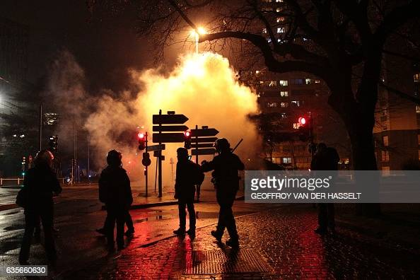 TOPSHOT An anti riot policeman walks in Bobigny northern Paris on February 16 2017 during a demonstration to demand justice for Theo a 22yearold...