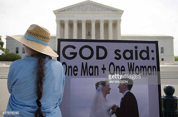 An anti samesex marriage demonstrator stands in front of the US Supreme Court in Washington DC June 18 awaiting the court's landmark decision AFP...