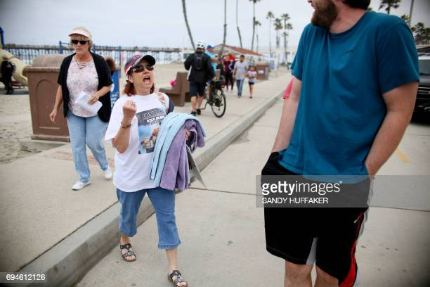 An anti Shariah Law supporter yells at an anti Trump supporter during the March For Human rights and Against Sharia law demonstration in Oceanside...