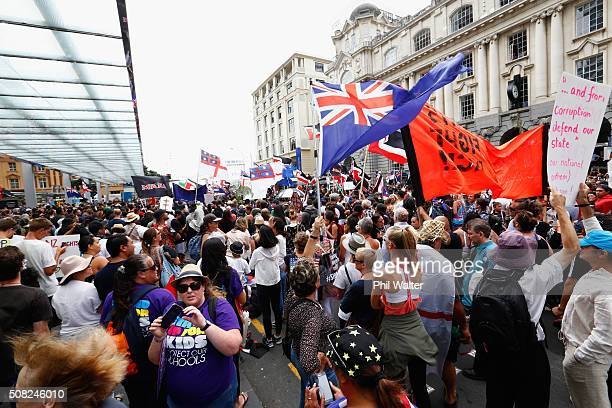 An anti TPP protest hikoi makes its way down Queen Street on February 4 2016 in Auckland New Zealand The signing ceremony marks the end of the TPP...