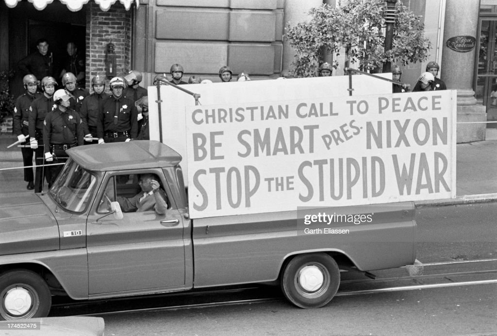 An anti Vietnam War protester drives a pickup truck near the St Francis Hotel where President Nixon was due to arrive San Francisco California August...