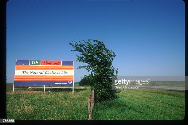 An antiabortion advertisement is on display in a field June 15 1998 in Kansas Twentyfive years after the Roe v Wade Supreme Court ruling which made...