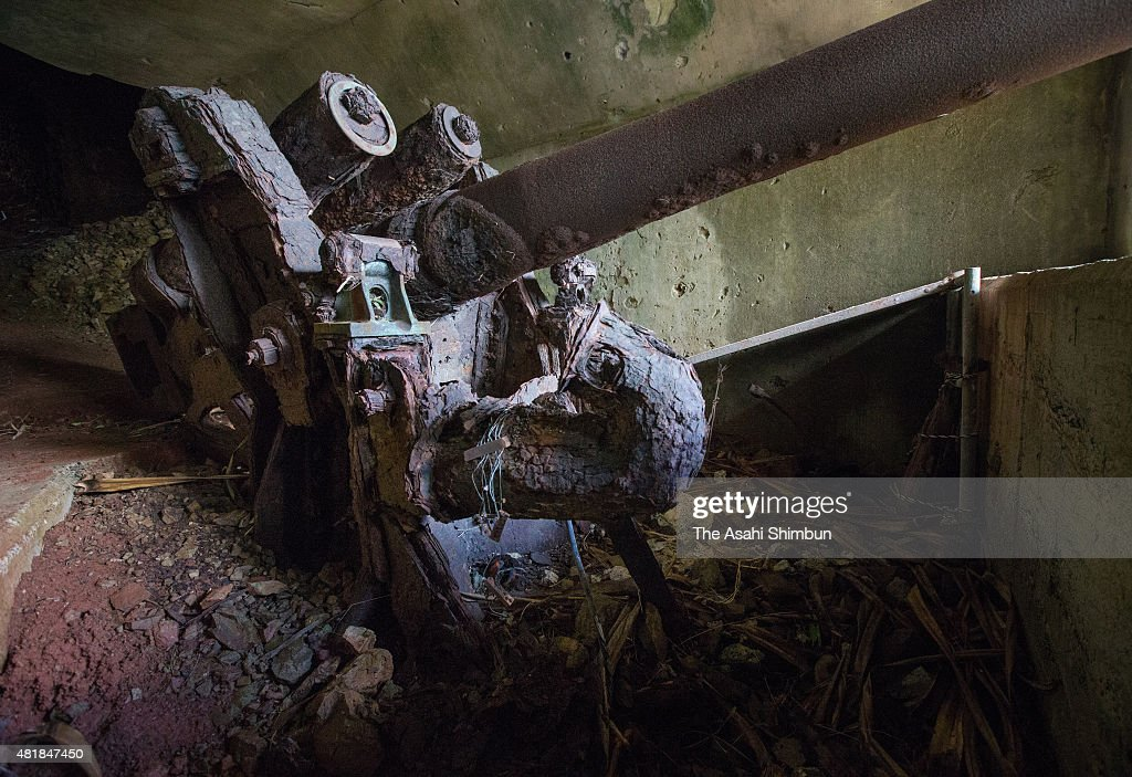 An antiaircraft artillery piece of the former Japanese forces remains at Yoakeyama on Chichijima Island on May 28 2015 in Ogasawara Tokyo Japan Along...