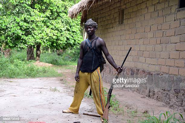 An AntiBalaka fighter stands in front of a house after residents took refuge in a Catholic church following an exSeleka rebels' incursion in Bouca on...