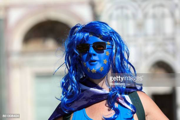 An antiBrexit campaigner wearing a face mask featuring the colors and stars of the European Union flag outside the Basilica di Santa Maria Novella in...