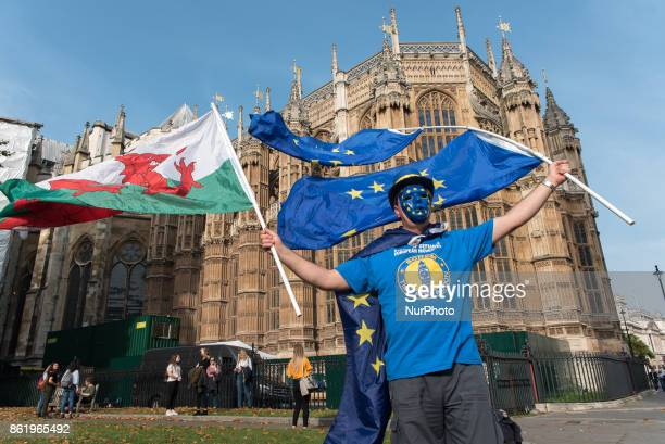 An antiBrexit demonstration with masks and flags takes place outside the Houses of Parliament in London on October 16 2017 Prime Minister Theresa May...