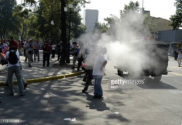 SANTIAGO CHILE An antiBush demonstration is sprayed with pepper gas by police during an unauthorized demonstration of some 100150 people as world...