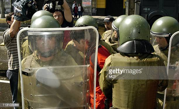 SANTIAGO CHILE An antiBush demonstrator is taken away by police during an unauthorized demonstration of some 100150 people as world leaders gathered...