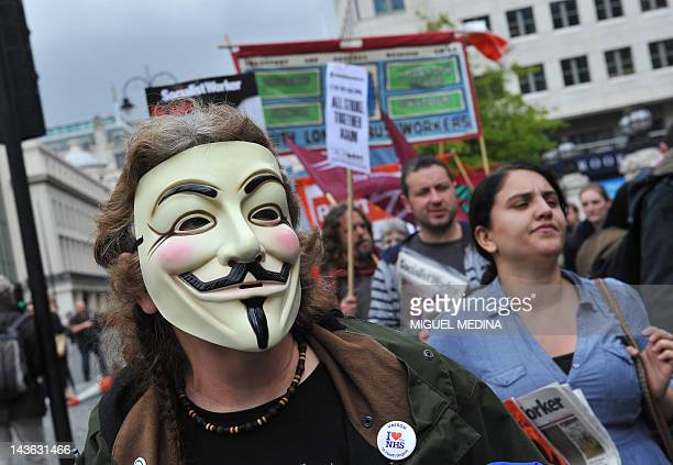 An anticapitalist protester from the 'Occupy' movement demonstrates on May 1 2012 in London Students trade unionists pensioners and activists from...
