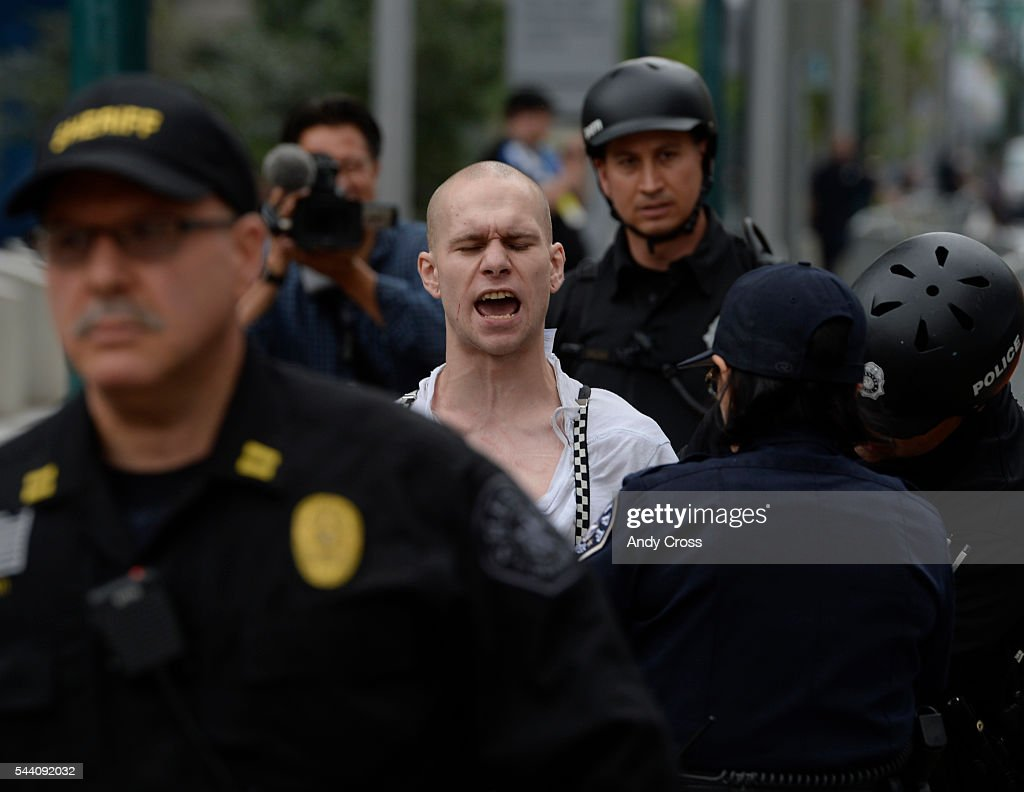 An anti-Donald Trump protester gets taken away after a scuffle iat a anti-Trump protest at the intersection of 14th and California, across the street from the Colorado Convention Center where Mr. Trump was speaking July 01, 2016.