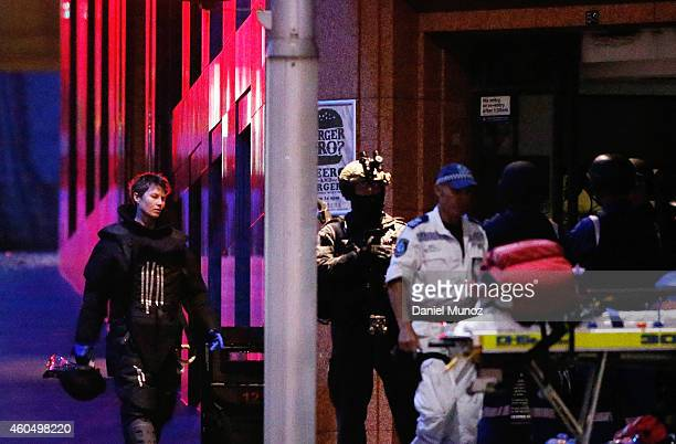 An antiexplosive police officer leaves the Lindt Cafe Martin Place during a hostage standoff on December 16 2014 in Sydney Australia Police stormed...