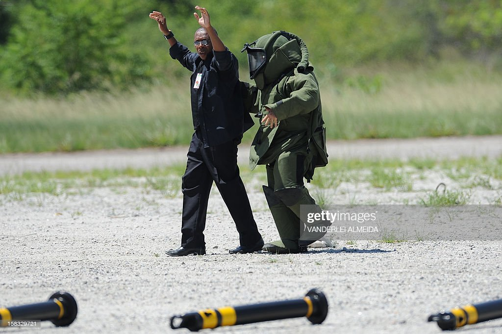 An anti-explosives expert from a police commandos from an anti-kidnapping unit arrests a 'terrorist' who was loaded with explosives during a drill at the Tom Jobim International Airport in Rio de Janeiro, Brazil, on January 13, 2012, ahead of the FIFA World Cup Brazil 2014 and the 2016 Olympic Games.
