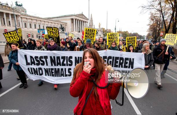 An antifascist demonstrator shouts slogans during a march towards the Austrian parliament on November 9 2017 in Vienna to protest against a possible...