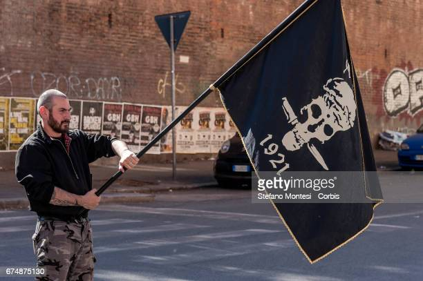 An Antifascist holds a flag as he takes part in a parade in remembrance of the struggle for liberation from Nazifascism on April 29 2017 in Rome...