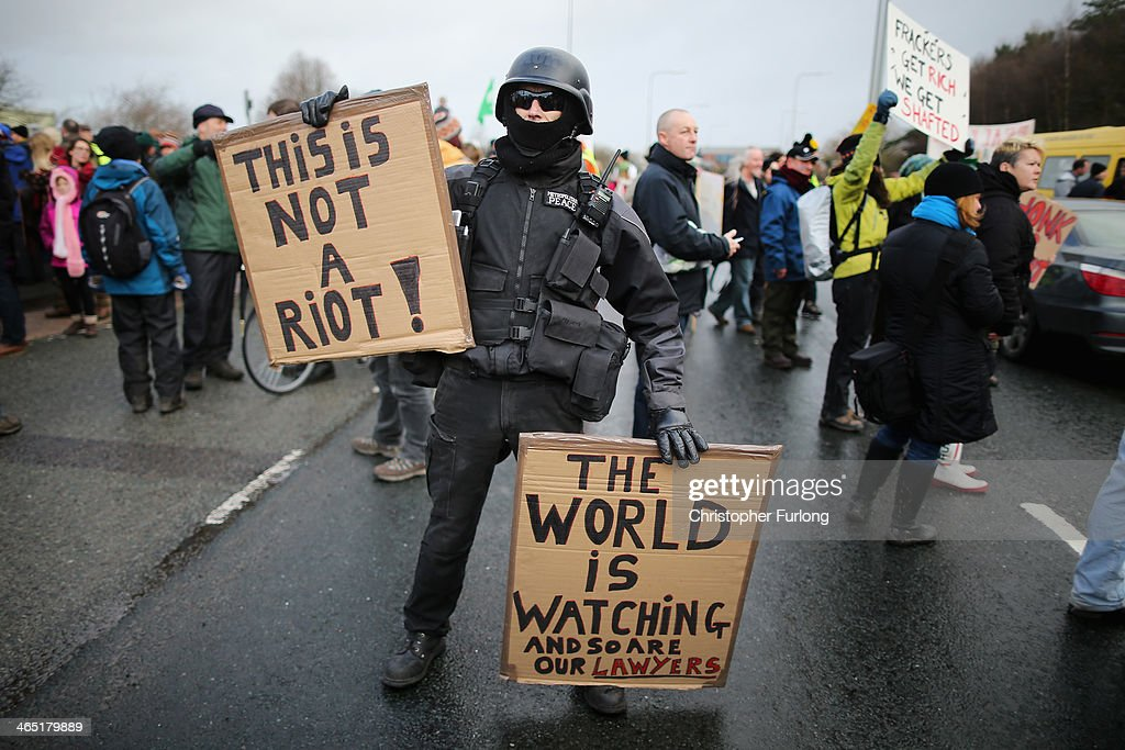 An anti-fracking campaigner, dressed as a riot policeman, takes part in a protest march near to the IGas Barton Moss fracking exploration rig on January 26, 2014 in Salford, England. Environmental protestors and anti gas fracking campaigners from across Britain marched to the Barton Moss gas exploration site run by Energy company IGas from Salford City Stadium.