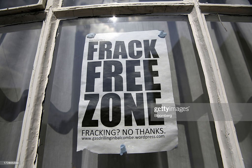 An anti-fracking protest sign sits in the window of a residential property near to Cuadrilla Resources Ltd.'s exploratory shale gas drill site in Balcombe, West Sussex, U.K., on Friday, July, 5, 2013. Two areas of Surrey and Sussex hold 700 million barrels of recoverable shale oil, or more than a year's supply for Britain, the U.S. Energy Information Administration estimates. Photographer: Matthew Lloyd/Bloomberg via Getty Images