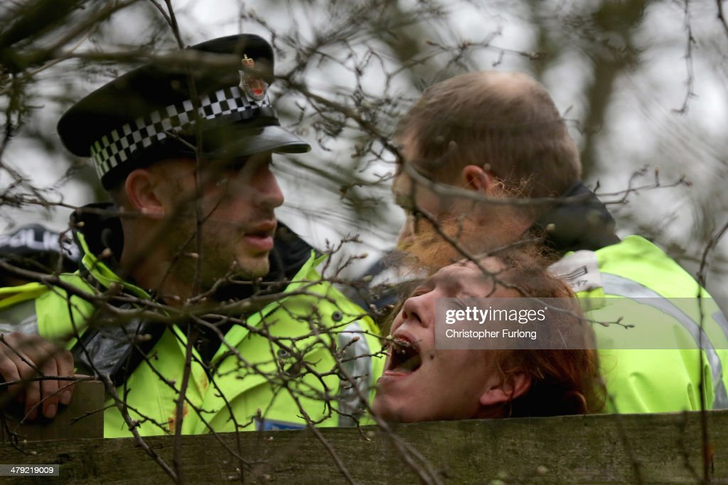 An antifracking protester is detained by police as campaigners block lorries trying to enter the Barton Moss fracking exploration site March 17 2014...