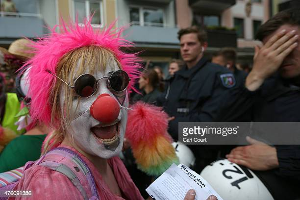 An antiG7 protester dressed as a clown takes part in a demonstration on June 6 2015 in GarmischPartenkirchen Germany G7 leaders will meet at nearby...