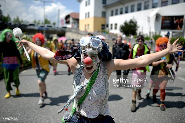An antiG7 protester gestures during a rally in GarmischPartenkirchen southern Germany on June 6 ahead of the G7 summit Germany will host the G7...
