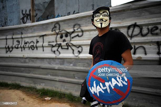 An antiglobalization activist protests against the construction of a Walmart megastore in a forest of the suburbian town of Mejicanos El Salvador on...