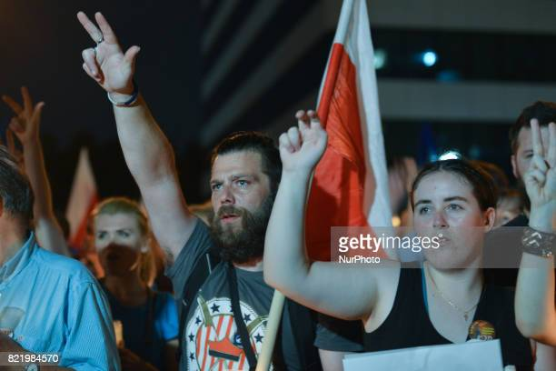 An antigovernment candlelit vigil in front of Krakow's District Court on Monday evening where hundreds gathered for the eighth consecutive night...