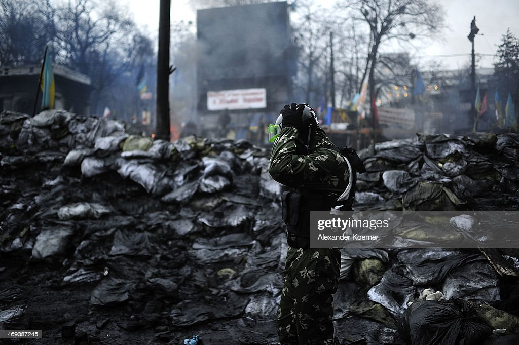 An anti-government protester gets ready to fight Berkut special police forces at a barricade on Grushevskogo Street on February 14, 2014, in Kiev, Ukraine. According to Opposition Officals, Berkut police forces could attack the barricades any moment; protesters have gathered inside and prepared fireworks and molotov-cocktails. Media and other people were removed from the barricades. Russian Foreign Minister Sergei Lavrov again issued a warning to the West against interfering in Ukraine's political crisis during today's joint press conference with German federal foreign Minister Walter Steinmeier, who is on a two-day visit to Russia. According to reports Ukrainian opposition leaders Vitaly Klitschko and Arseny Yatsenyuk are set to meet with German Chancellor Angela Merkel on February 18, 2014 in Germany.