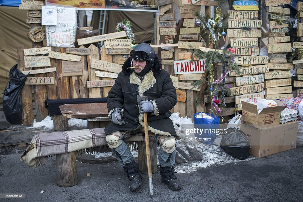 An anti-government protester in Independence Square on January 28, 2014 in Kiev, Ukraine. Ukraine's parliament is holding a special session called over continuing unrest in the country and Prime Minister Mykola Azarov has offered to resign.