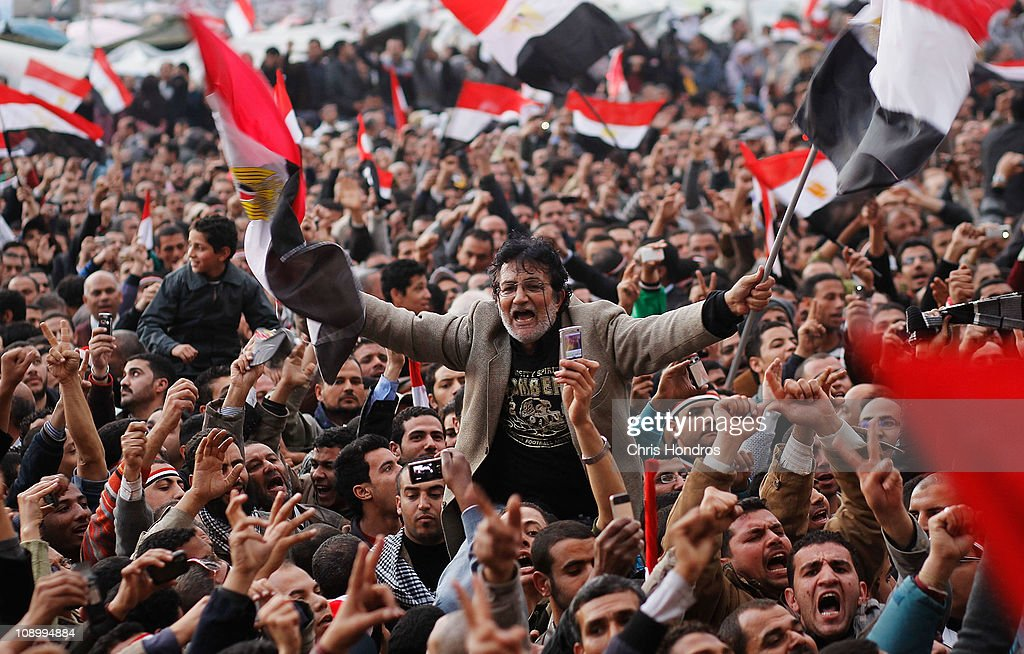 An antigovernment protester is carried on shoulders in Tahrir Square in the afternoon before a speech by Egyptian President Hosni Mubarak in Tahrir...