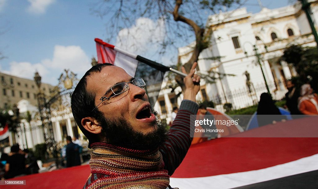 An anti-government protester shouts in front of the Egyptian Parliament building Feburary 9, 2011 in Cairo, Egypt. Thousands of Egyptians protested outside of the parliament building in downtown Cairo to demand the assembly's immediate dissolution as part of a wave of anti-government protests in the nearby Tahrir Square.