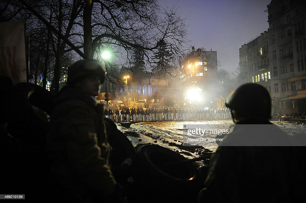 An anti-government protester stands inside a barricade on Grushevskogo Street on February 13, 2014 in Kiev, Ukraine. Opposition party leader of UDAR Vitali Klitschko called out a national strike for today across the Ukraine.