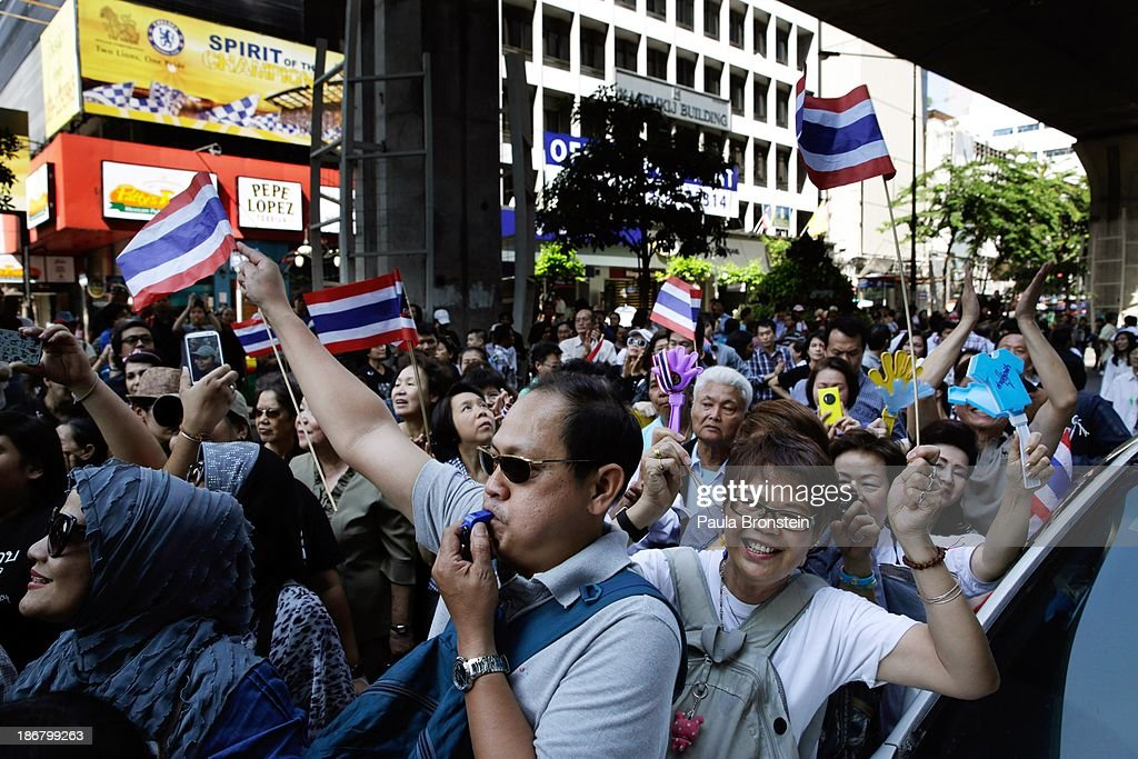An anti-government protestors cheer during a downtown rally against a controversial Amnesty bill that passed in Parliament last week on November 4, 2013 in Bangkok, Thailand. Thousands attended various protests around the capitol city organised by the opposition Democrat Party. If the law goes into effect protestors fear it could whitewash all crimes for which the billionaire former leader Thaksin Shinawatra was convicted, setting the stage for him to return to Thailand.