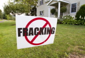 An antihydrofracking sign stands near the Ommegang Brewery in Cooperstown New York US on Tuesday Aug 17 2011 Brewery Ommegang says a leak of fracking...