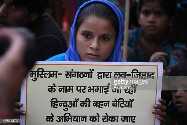 An antiLove Jihad Hindu Girl holds placard during a protest against 'Love Jihad' at New Delhi Love Jihad is an alleged activity under which young...