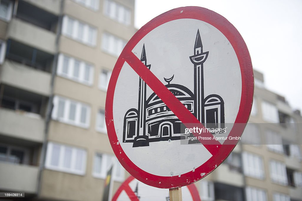 An anti-Mosque placard belonging to German radical rightwing-party 'Pro Deutschland' is displayed as Salafites hold benefit rally for Syrian Muslims on January 13, 2013 in Berlin. Two dozen members of 'Pro Deutschland' waited in the centre of Berlin for Salafites who originally planned to hold a public gathering to raise money for Muslims in Syria, which included prominent speakers such as radical Islamic preacher Pierre Vogel. They then moved the event to a private gathering in Neukoelln district. Salafites are an ultra-conservative group of Muslim sunnis with hundreds of members in Berlin and the area around Bonn and cologne. German authorities are keeping a close eye on the group, espacially since clashes that broke out last year in which Salafite demonstrators attacked police and right-wing counter-demonstrators. on January 13, 2013 in Berlin, Germany.