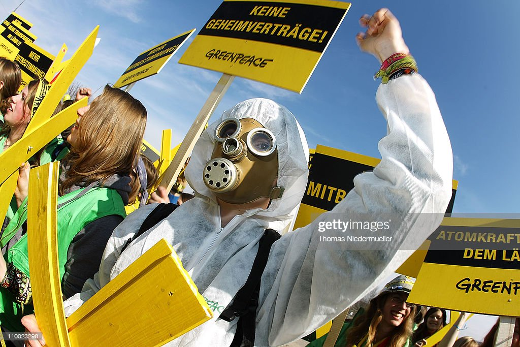 An anti-nuclear activist wearing a gas mask protests together with other activists in front of the Neckarwestheim nuclear power plant on March 12, 2011 near Neckarwestheim, Germany. The activists were protesting against the government-granted extension of the operational timespan of several of Germany's older nuclear power plants, which Chancellor Merkel's government claims is necessary to bridge demand before planned renewable energy projects begin operation. The activists claim their call for an end to nuclear power is all the more vital given the current, potential catastrophe brewing at at least one reactor at the tsunami-damaged Fukushima facility in Japan.