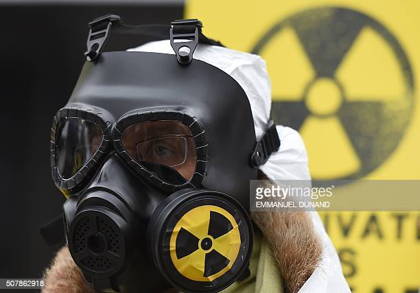 An antinuclear activist wears a gas mask during a protest against what they alledge to be a lack of safety measures at Belgian nuclear power plants...