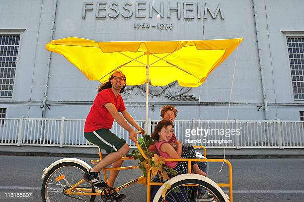 An antinuclear power activit and two children pass by Fessenheim's hydroelectric power plant over The Grand Canal of Alsace part of the Rhine river...
