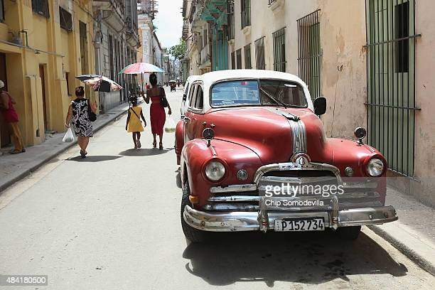 An antique Americanmade automobile is parked in the old part of the city August 14 2015 in Havana Cuba The first American secretary of state to visit...