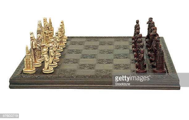 an antique chess board and chess men
