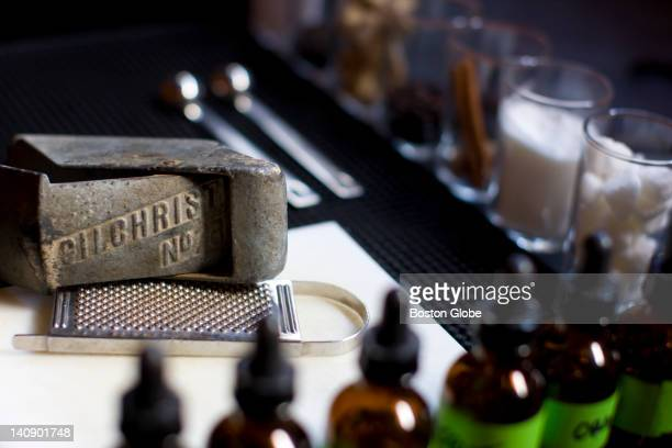An antique ice shaver used for drinks such as juleps and cobblers sits on the bar at Drink a retrosleek bar in South Boston's Fort Point area where...