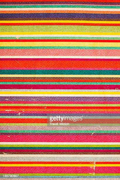 An antique piece of paper with varying colored lines