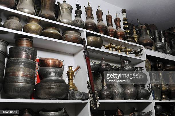 An antique shop sells Afghan silver and copper ware displayed in a shop in Chicken Street on October 17 2011 in Kabul Afghanistan Chicken Street has...