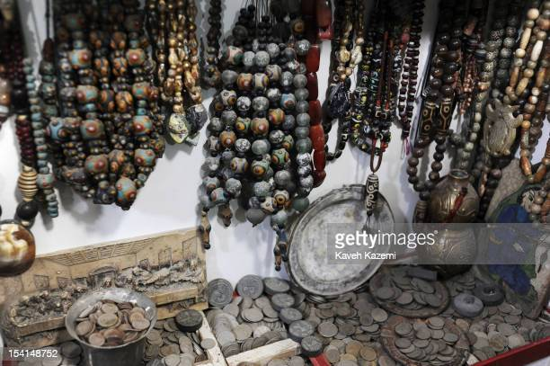 An antique shop sells Afghan silver coins in Chicken Street on October 17 2011 in Kabul Afghanistan Chicken Street has been a focus for Afghanistan's...