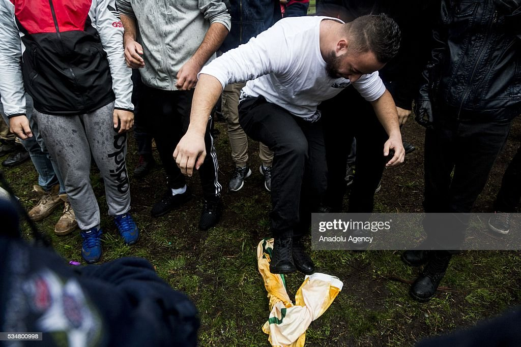 An anti-racist protestor stomps on a UPF (united patriots front) flag during a 'Say No To Racism' protest and a counter 'Stop the Far Left' rally in Coburg Melbourne, Australia on May 28, 2016. Seven men were arrested after a violent brawl erupted between rival protesters at an anti-racism rally in Melbourne's inner-north. Anti-Facists clashed with Anti-Islam nationalists who go by the name 'True Blue Crew'.