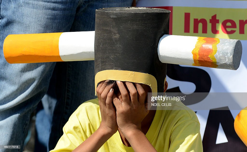 An anti-smoking protester wears a head piece at a rally at the entrance gate of the World Trade Center in Manila on March 20, 2013 where the world's biggest tobacco trade show is being held. The United Nations has expressed concern that the Philippines could encourage smoking by hosting one of the world's biggest tobacco trade shows, a health official said on March 20. UN agencies in the Philippines have written to President Benigno Aquino citing Manila's treaty pledge to ban tobacco advertising, promotion and sponsorship, World Health Organisation senior health adviser Eigil Sorensen said.